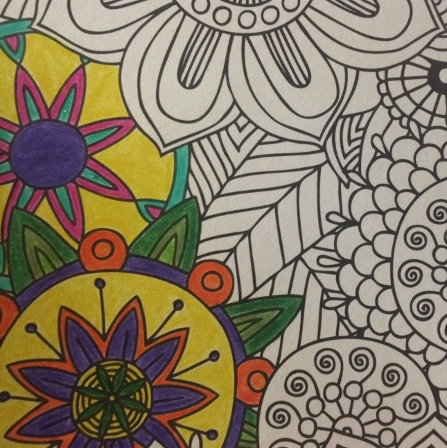 "I started coloring this page from ""Coloring on the Go: Floral Designs for Fun and Relaxation."""